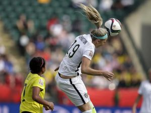 Julie Johnston of the United States' back line showing her strength in the air against Colombia. (Photo: Eric Schlegel/USA TODAY Sports)