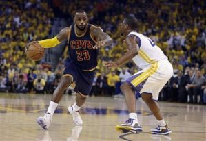 LeBron James driving to the hoop against Harrison Barnes (AP Photo/Ben Margot)
