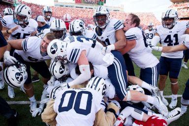 BYU celebrate after beating Nebraska on a Hail Mary. (Omaha.com)