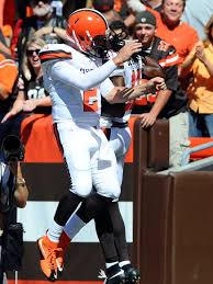 Manziel celebrates one of two TD passes to Travis Benjamin (USA Today)
