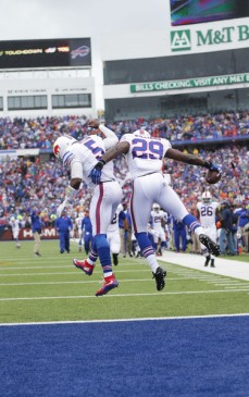 Karlos Williams and Tyrod Taylor celebrate after Williams scored his first career touchdown. (Getty Images)