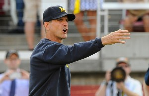 Jim Harbaugh will look to guide him alma mater to their first win of the season on Saturday (Getty Images)