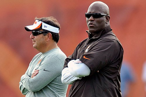 Mike Lombardi (former GM) and Ray Farmer (current GM) watch a Browns practice in 2013. (Photo via SI)