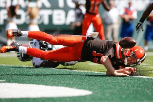 Josh McCown fumbles in the endzone and suffers a concussion. (AP Photo)