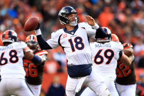 Peyton Manning throws one of his three INTs Sunday in Cleveland (AP Photo)