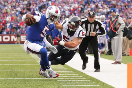 Tyrod Taylor tiptoes the sideline on his way to scoring on of his 4 total TDs Sunday (Getty Images)