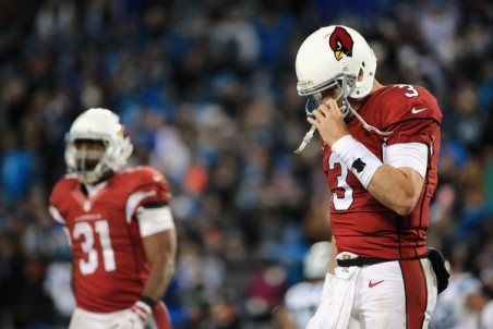 Carson Palmer hangs his head after one of his 6 turnovers against the Panthers. (Getty Images)