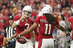 A rejuvenated Carson Palmer and Larry Fitzgerald are trying to win their first Super Bowl. (Getty Images)