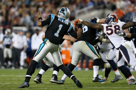 Von Miller gets one of his two strip sacks of Cam Newton. (Getty Images)