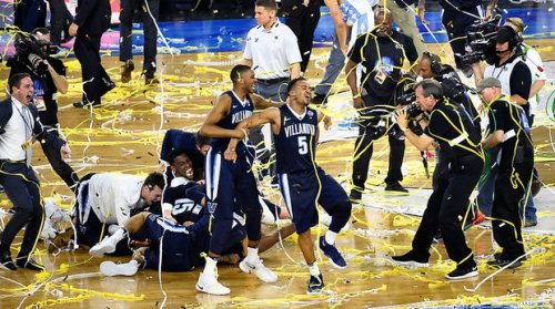 Villanova celebrates after Kris Jenkins buzzer beater won them the National Championship. (Getty Images)