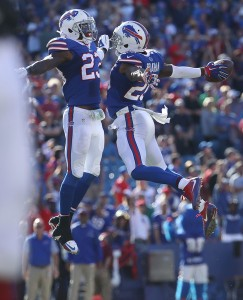 Corey Graham and Aaron Williams celebrate one of Carson Palmer's 4 interceptions. (Getty Images)