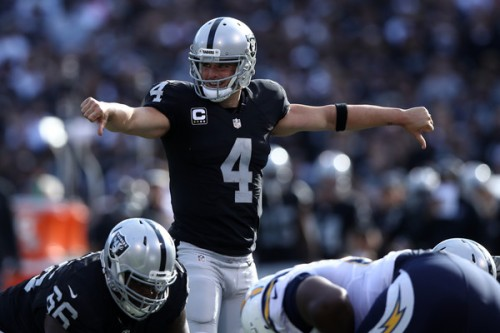 Derek Carr's elevated play has been bailing out the Oakland defense all season. (Getty Images)