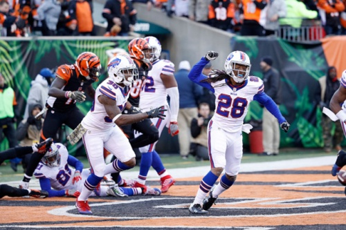 The Bills celebrate sneaking out of Cincinnati with a win. (Getty Images)
