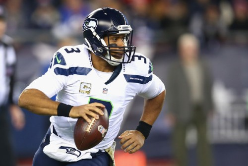 Russell Wilson pulled off one of the most difficult tasks in football, beating Brady on the road. (Getty Images)