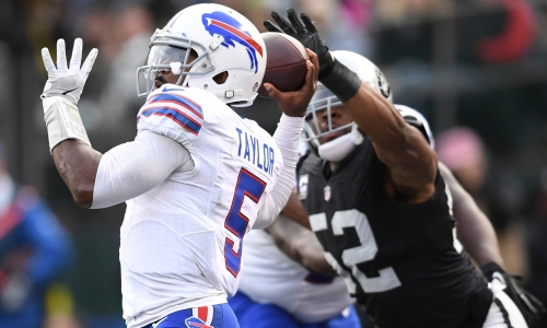 Tyrod Taylor's interception after Khalil Mack tipped his pass was the icing on the Bills collapsing cake. (Getty Images)