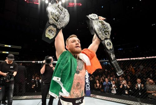 Conor McGregor and his two belts had quite the year. (Getty Images)